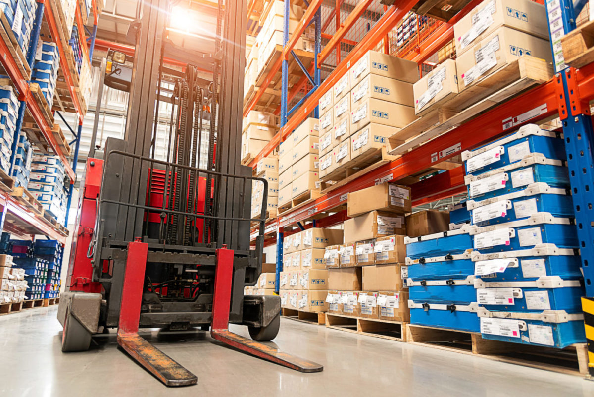 Forklift Truck Loader. Huge Distribution Warehouse With High Shelves Background.